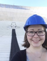 Emily Petroff on the dish of the telescope.