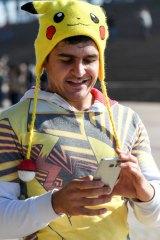 A Pokemon Go fans in Sydney on Sunday.