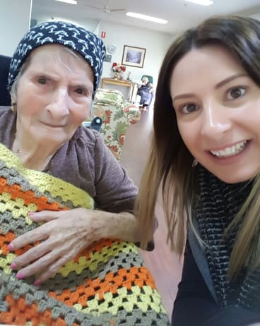 Nanna with one of her grandchildren, Stephanie, the author's sister, in September last year ... a very different face from that of seven years earlier.