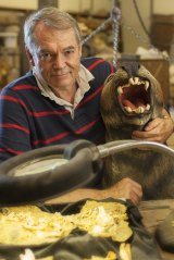 The Lazarus Project's Professor Michael Archer holding a life-sized model of an extinct Marsupial Lion. He has no plans to bring this particular carnivore back to life