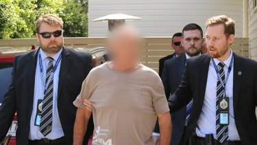 Queensland Police arrest Chris Dawson at a home on the Gold Coast on Wednesday morning.