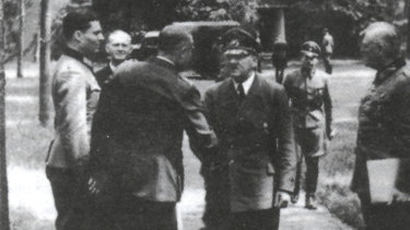 Hitler and Colonel Claus von Stauffenberg (extreme left), who later plotted to assassinate him.