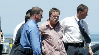 Carl Williams is arrested at Port Melbourne in 2003.