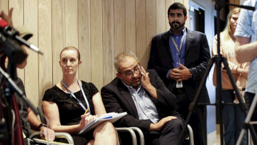 Vascular surgeon Adib Khanafer (centre) wipes his eye after speaking at Wednesday's press conference, flanked by Christchurch Hospital surgical nursing director Nicky Graham (left) and Dr Dominic Fleischer.