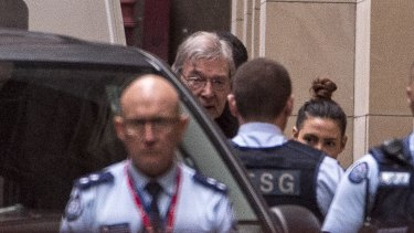 Cardinal George Pell arrives at the Supreme Court on Wednesday morning, wearing a black suit and clerical collar.