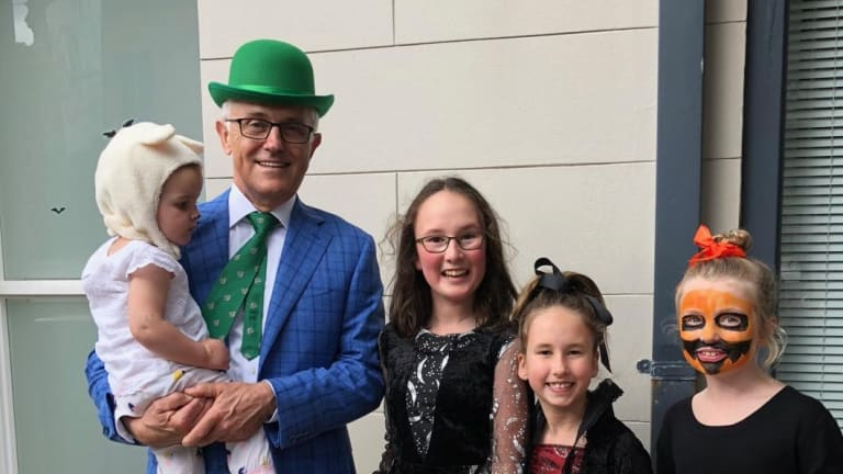 Former prime minister Malcolm Turnbull with Astrid Gardan, Saskia Gardan and Sofia White, trick or treating for Halloween.