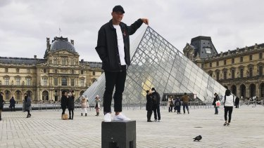 Paris moments: Joseph Manu has fun at the Louvre during the Roosters' downtime in the French capital.