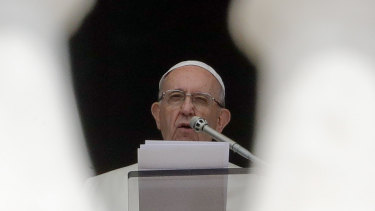 Pope Francis delivers his speech during the Angelus noon prayer he recited from the window of his studio overlooking St Peters Square on Wednesday.