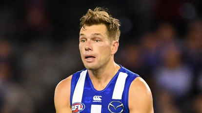 Higgins ends trade speculation by extending North Melbourne contract