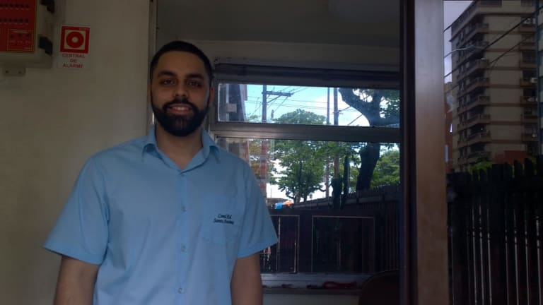 Jose Claudio Dias Jnr grew up in a crooked building where he now works. He is also studying civil engineering.