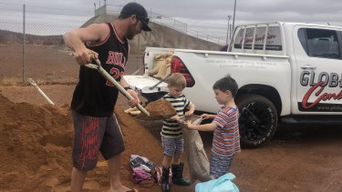 Families have prepared for surging flood waters.