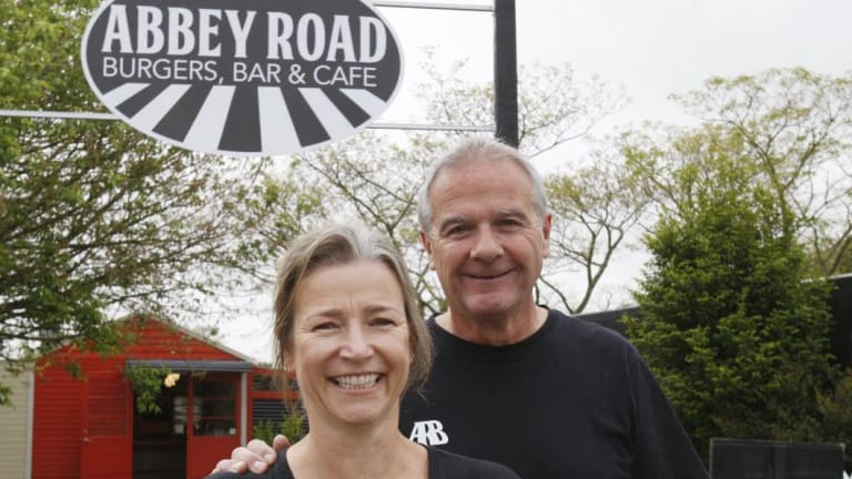 Abbey Road Burgers owner Fabian Prioux (right) does not allow children into the cafe.