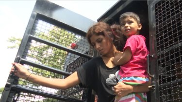 Pakistani Christian refugees arrive at the Immigration Detention Centre in Bangkok, Thailand.