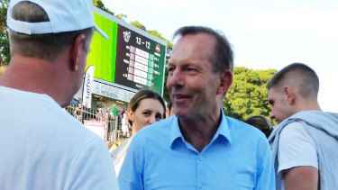 Happy fan: More than 12,000 supporters, including Tony Abbott, saw a gripping encounter.