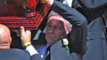 Borce Ristevski carries his wife's coffin at her funeral in March 2017.