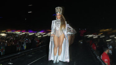 Beyonce enters in appropriately regal fashion.