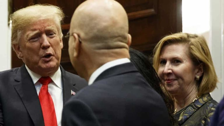 US Deputy National Security Adviser Mira Ricardel watches as Donald Trump arrives for a Diwali ceremonial lighting of the Diya in the White House on Tuesday.