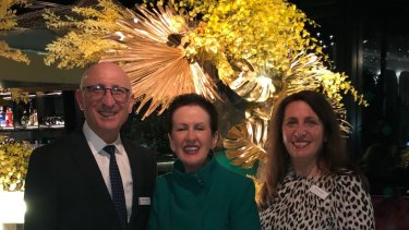 Bernard Pollak and Barbara Pollak celebrate half a century of their Sydney floristry empire with Lord Mayor Clover Moore.