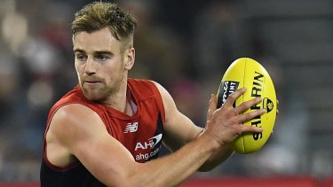 On the way to North? Melbourne midfielder Dom Tyson.