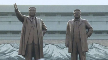 North Korean crowds gather at the unveiling of statues of Kim Il-sung and Kim Jong-il.