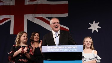 Scott Morrison takes to the stage on Saturday night with wife Jenny and children Abbey and Lily to declare his election victory a miracle.