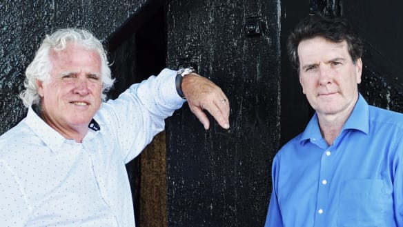 CFMEU national secretary Michael O'Connor and MUA national secretary Paddy Crumlin have defeated a challenge to their union merger.