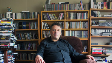 Martin Phillips with some of his vast collection of books and CDs.