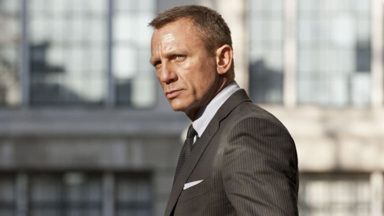 You can bet your bottom dollar you'd get great service at the car dealer's if you brought Daniel Craig, silent in his suit.