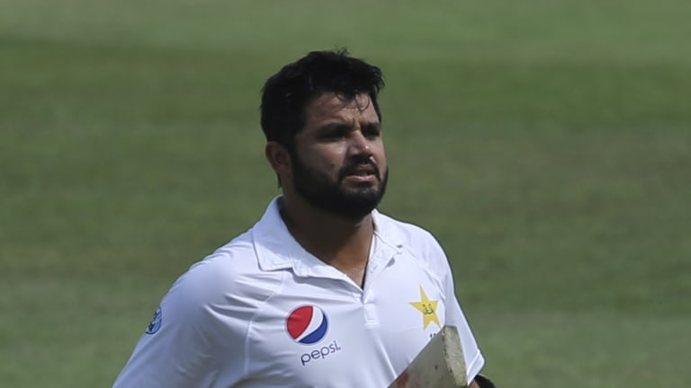 Boundary rider: A bemused Azhar Ali leaves the field after being run out.