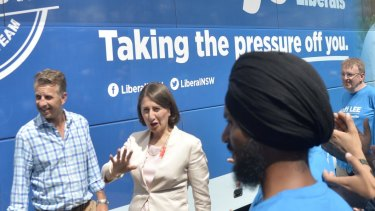 Premier Gladys Berejiklian and Transport Minister Andrew Constance arrive at Westmead train station to announce an extra $3.4 billion on the Metro West if she wins this month's election.