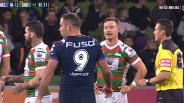 Score to settle: Souths hooker Damien Cook stares down his opposite number Cameron Smith.