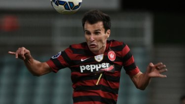 Back in black and red: Labinot Haliti is set for a coaching return to the Western Sydney Wanderers.