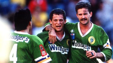 Raiders hooker Steve Walters celebrates the '89 premiership with Gary Belcher and Laurie Daley.