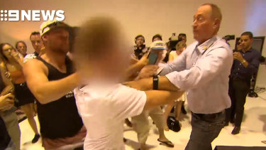 Fraser Anning strikes the young activist who egged him.