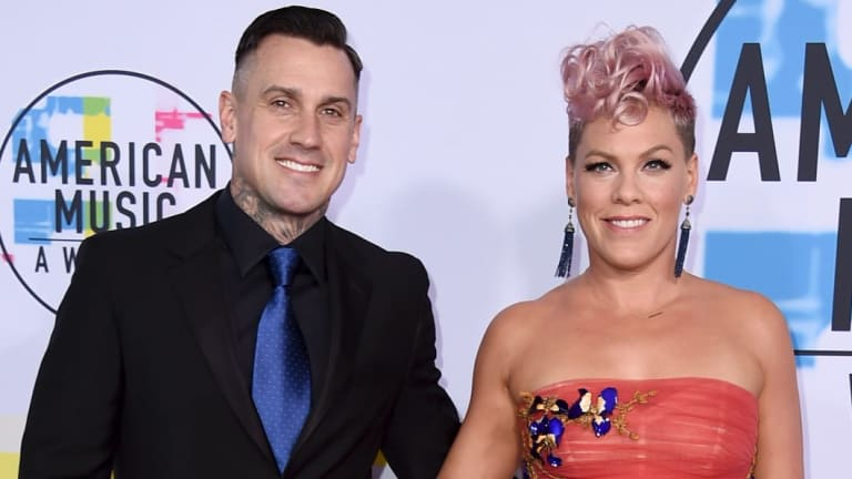 Carey Hart, left, with wife Pink.