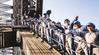 Tourists on the Harbour Bridge climb in Sydney.