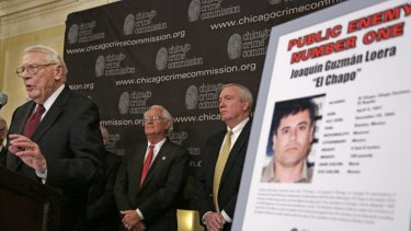 """Art Bilek, left, of the Chicago Crime Commission, announces  in 2013 that Joaquin """"El Chapo'' Guzman, the head of Mexico's Sinaloa Cartel, has been named Chicago's Public Enemy No. 1."""