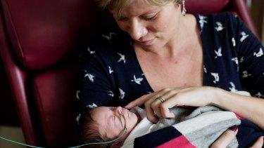 Hayley Mackay holds her new born baby son Alfie.