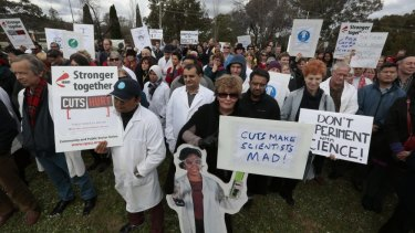 CSIRO employees donned lab coats as they vented their fury about budget cuts in Canberra on Thursday.