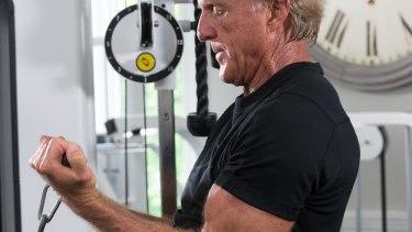 Greg Norman works out everyday. His sessions include three sets of cable bicep curls, 12 reps each.