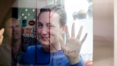 A transparent touchscreen operates as a fridge door.