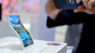 A curved screen prototype. With new OLED technology, one can 'print' a screen onto basically any shape.