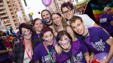Students, police and the public celebrate Wear it Purple day in Sydney on Friday.