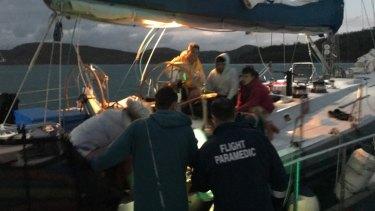 Paramedics treated the woman aboard the maxi yacht.