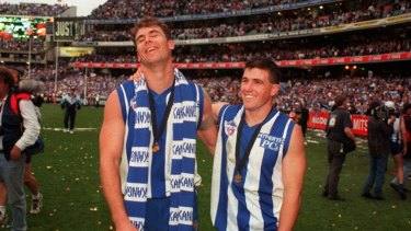Wayne Carey and Anthony Stevens as teammates, after the 1996 Grand Final won by North Melbourne.