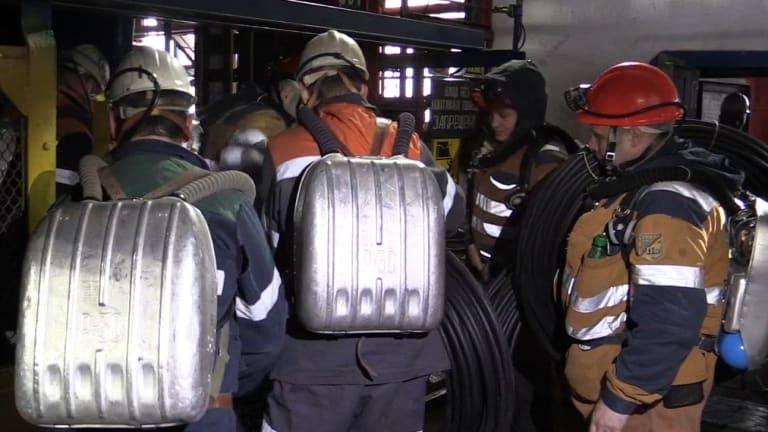 Rescuers getting on an elevator in Vorkuta, Russia.