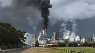 Smoke billowing from the Altona refinery as a storm rolls into Melbourne on Friday, November 17.