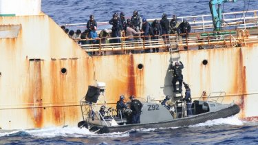 Australian officers investigate the illegal fisher Perlon in the Indian Ocean.