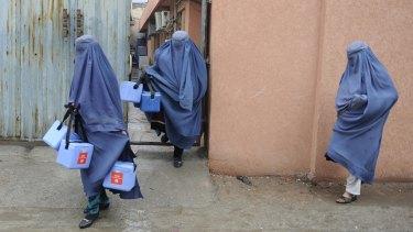 Female volunteer polio vaccinators in Afghanistan.