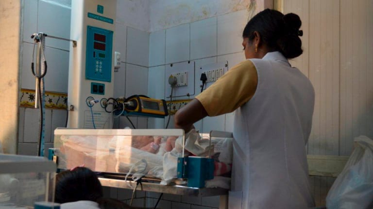 A baby born to a surrogate mother in the premature baby ward in India.